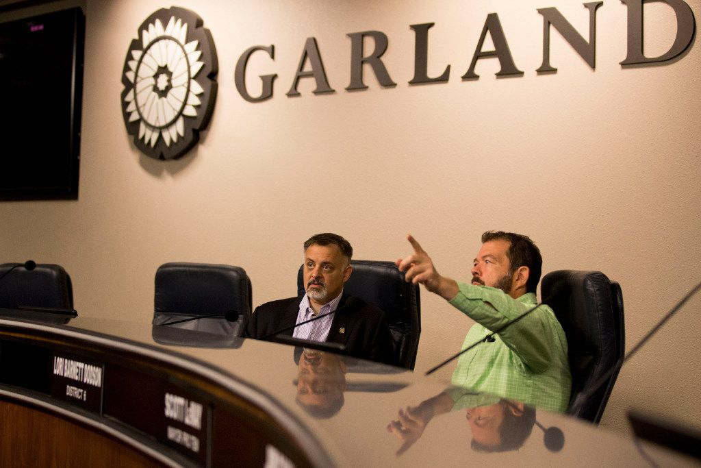 Dan Bach (right), Garland's video services manager, helps Garland City Council member Rich Aubin become familiar with technology at Garland City Hall.