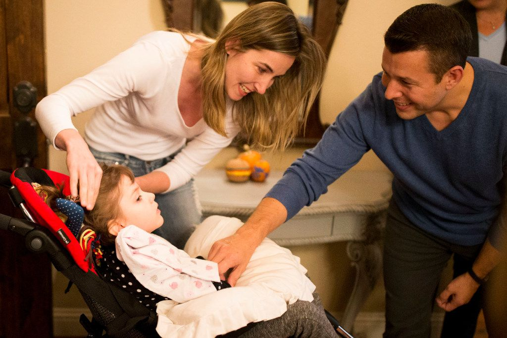Dustin Howard (right), father of Harper Howard, greets Anny Fischer, 8, of Brasília, Brazil who suffers CDKL5, a rare genetic disorder. (Ting Shen/The Dallas Morning News)
