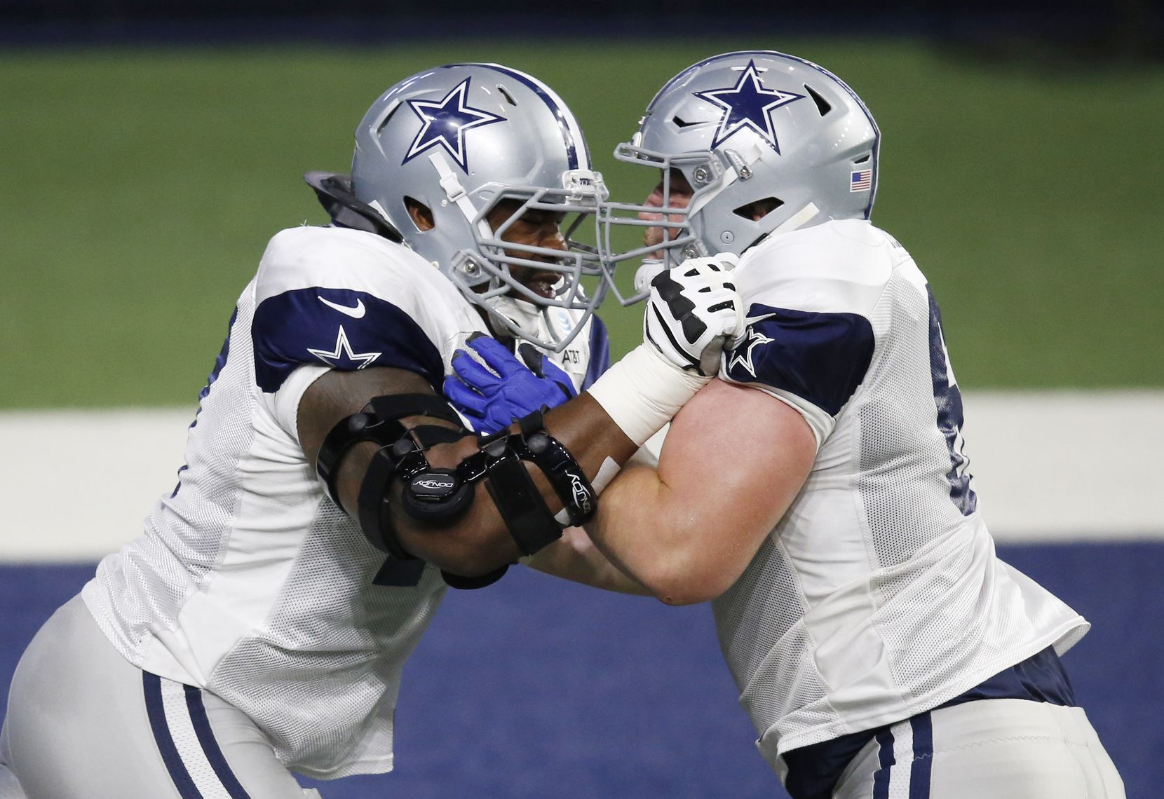 Dallas Cowboys offensive tackle Tyron Smith (77) blocks Dallas Cowboys center Adam Redmond (61) in a drill during training camp at the Dallas Cowboys headquarters at The Star in Frisco, Texas on Thursday, August 27, 2020. (Vernon Bryant/The Dallas Morning News)