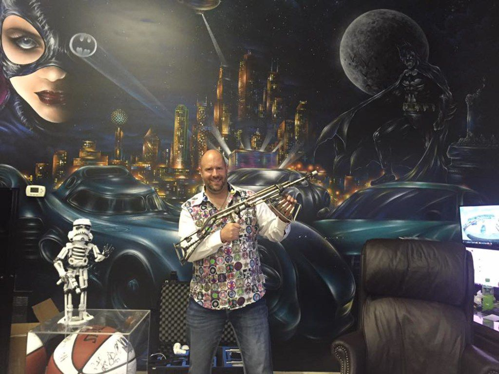 An owner of the used-car dealership 1and2 Automotive that The Watchdog called  one of the worst in town,  David Kost Jr. poses in a public Facebook cover photo.