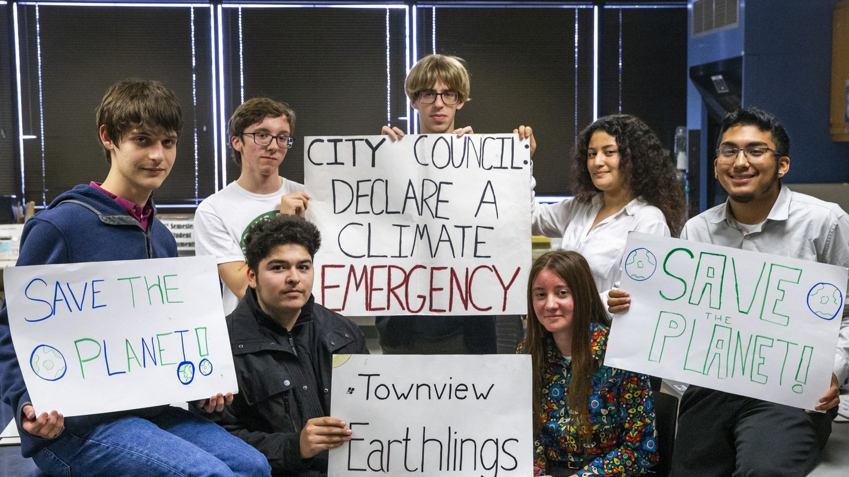 The members of the Earthlings environmental activism club at the Yvonne A. Ewell Townview Magnet Center in Dallas have been organizing to urge local officials to take action on climate change. From left to right: Drew Easley, Richard Herrera, Jonathan Cartwright, Gideon Krieger, Janet Shuey, Claudia Gomez and Brandon Hernandez.