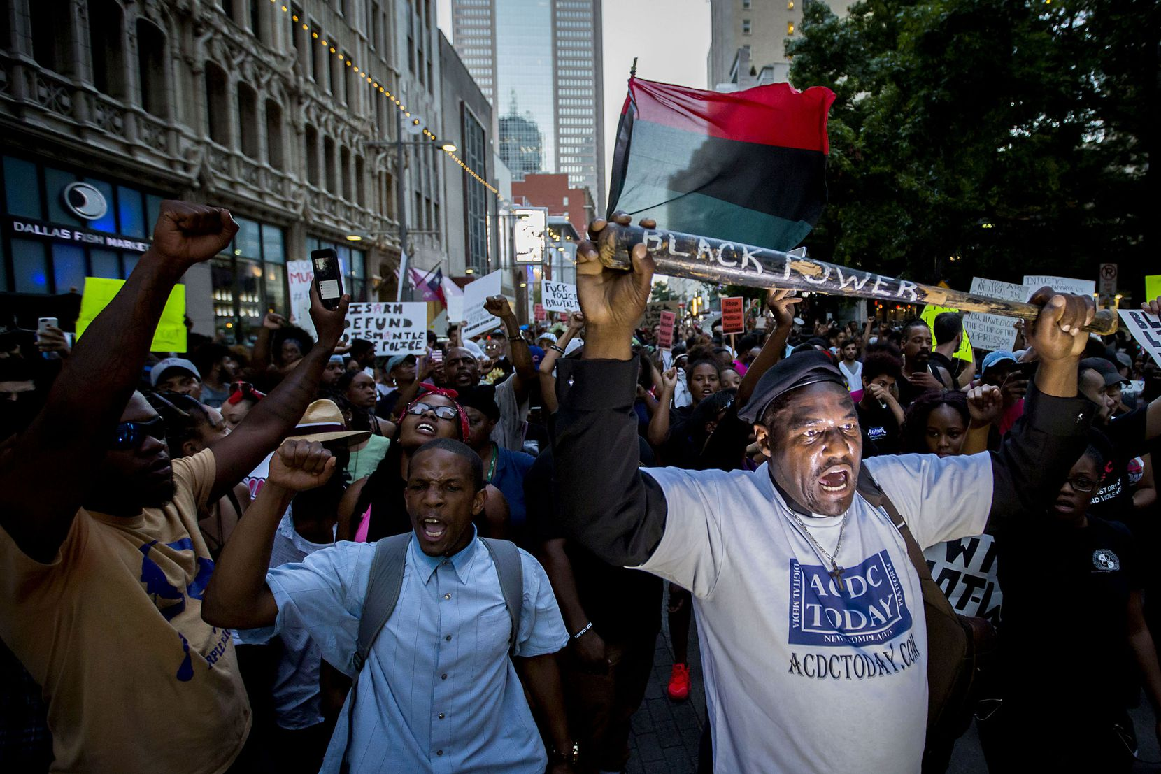 Ernest Walker led other protesters at Thursday night's rally in downtown Dallas, which was organized after the killings of Alton Sterling by police officers in Baton Rouge, La., and Philando Castile in Minnesota..