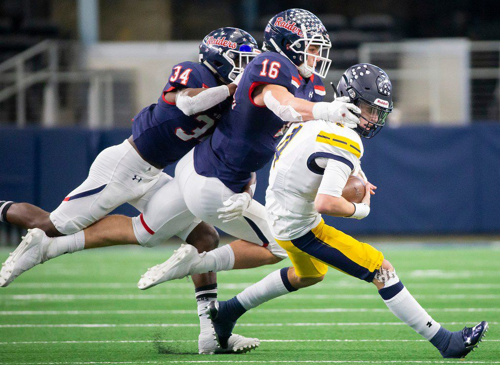 Highland Park quarterback Chandler Morris (4) is brought down by Denton Ryan linebacker  Drew Sanders (16) and defensive end Delshun Neal (34) during the first half of a Class 5A Division I state semifinal state semifinal at AT&T Stadium on Saturday, Dec. 15, 2018, in Arlington. (Smiley N. Pool/The Dallas Morning News)
