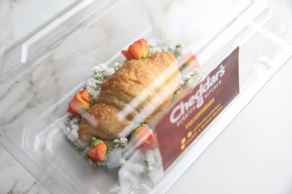 The croissant corsage comes packaged in a tidy plastic box.