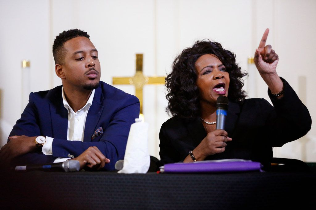 Attorney Justin Moore listens as District Attorney Faith Johnson speaks at a town hall following the death of Botham Jean, who was shot and killed in his apartment by an off-duty Dallas police officer. (Rose Baca/Staff Photographer)