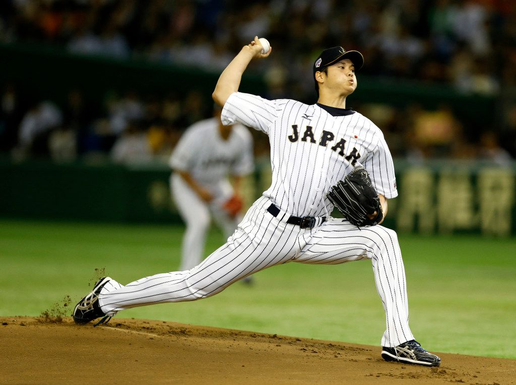 FILE - Japan starter Shohei Otani pitches against South Korea during the first inning of a semifinal game at the Premier12 world baseball tournament in Tokyo on Thursday, Nov. 19, 2015. (AP Photo/Toru Takahashi)
