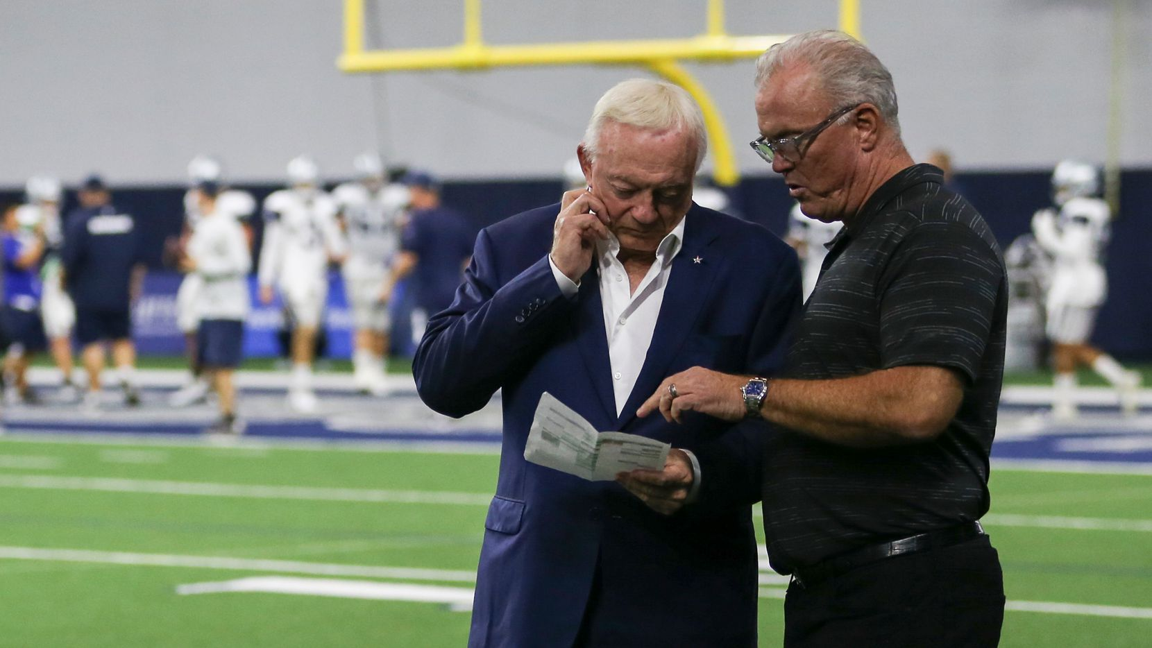 Jerry Jones, left, and Stephen Jones attend a Dallas Cowboys practice on Tuesday, Aug. 27, 2019 at The Star in Frisco, Texas. (Ryan Michalesko/The Dallas Morning News)