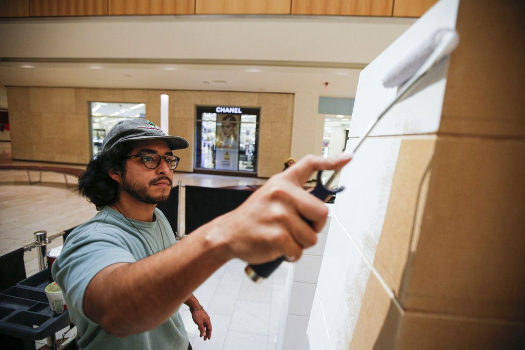 Artist Drigo, Eric Rodriguez, uses primer as a base for his piece 'Growing Up' at Galleria Dallas, Wednesday, March 11, 2020. (Brandon Wade/Special Contributor)