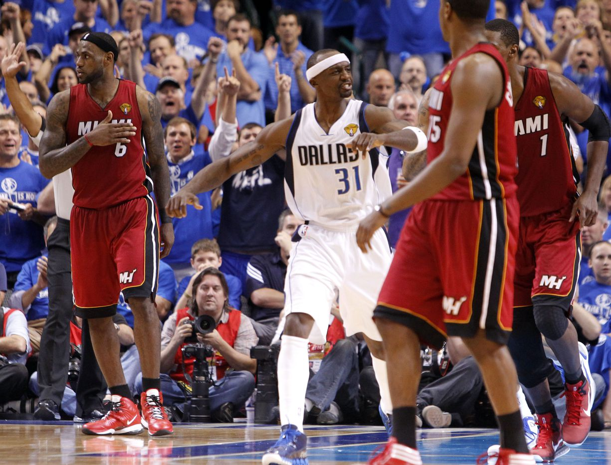 Dallas Mavericks shooting guard Jason Terry (31) shows some attitude as he heads upcourt after hitting a shot beside Miami Heat small forward LeBron James (6) in the fourth quarter during Game 4 of the NBA Finals at American Airlines Center Tuesday, June 7, 2011 in Dallas. The Mavericks won 86-83 to tie the series at 2-2.   (Louis DeLuca/The Dallas Morning News)