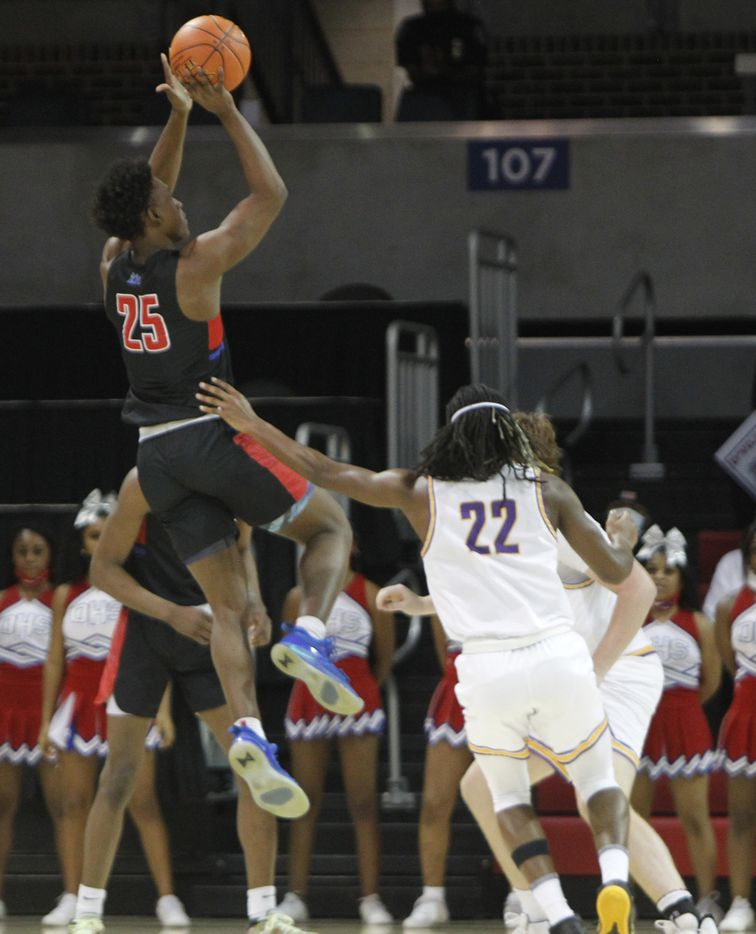 Duncanville guard Damon Nicholas (25) hits a jumps shot as Richardson guard Cason Wallace (22) looks on during first half action. The two teams played their Class 6A state semifinal boys basketball playoff game at Moody Coliseum on the campus of SMU in Dallas on March 9, 2021. (Steve Hamm/ Special Contributor)