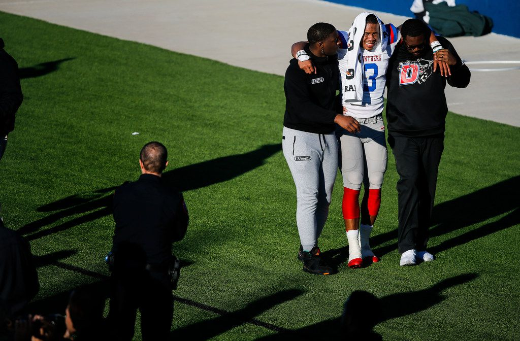 Duncanville quarterback Ja'Quinden Jackson (3) is helped off the field after being injured during the first half of a Class 6A Division I state semifinal football matchup between Rockwall and Duncanville on Saturday, Dec. 14, 2019 at McKinney ISD Stadium in McKinney, Texas. (Ryan Michalesko/The Dallas Morning News)