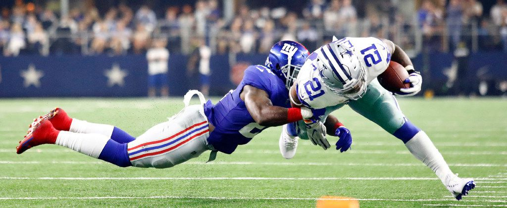 FILE - New York Giants strong safety Landon Collins (21) dives at Dallas Cowboys running back Ezekiel Elliott (21) to force him out bounds in the first half at AT&T Stadium in Arlington, Texas, Sunday, September 10, 2017. (Tom Fox/The Dallas Morning News)