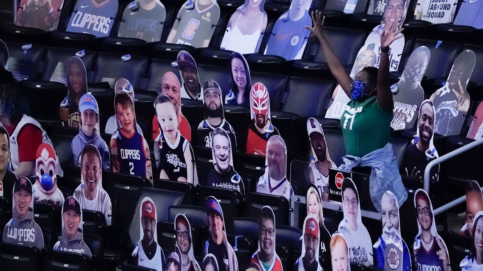A Dallas Mavericks fan celebrates a113-103 victory over the LA Clippers in an NBA playoff basketball game at Staples Center on Saturday, May 22, 2021, in Los Angeles.