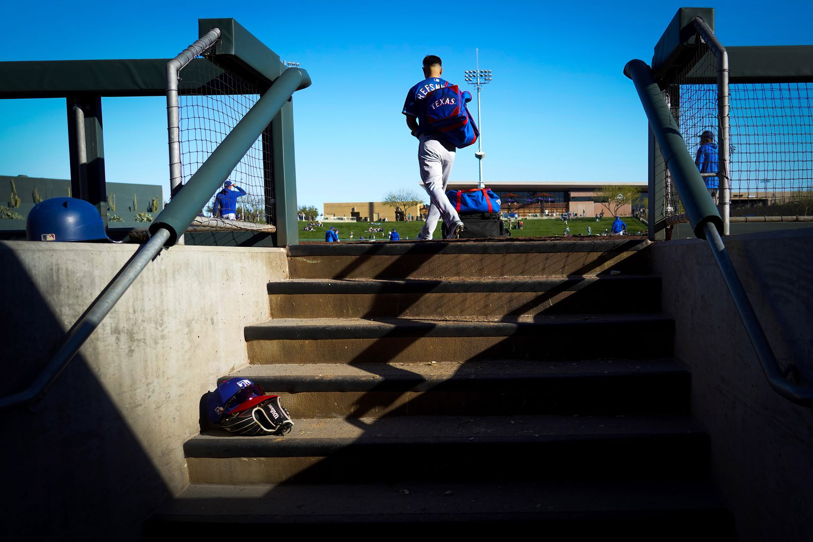 Texas Rangers outfielder Rob Refsnyder heads to the team bus after a 4-3 loss to the Colorado Rockies in a spring training game at Salt River Fields at Talking Stick on Wednesday, Feb. 26, 2020, in Scottsdale, Ariz.