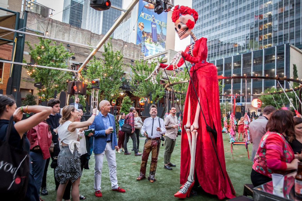 A tall skeleton-like figure walks among the partygoers at the Eye Ball Party celebrating the Dallas Art Fair in Dallas. (Ron Heflin/Special Contributor)