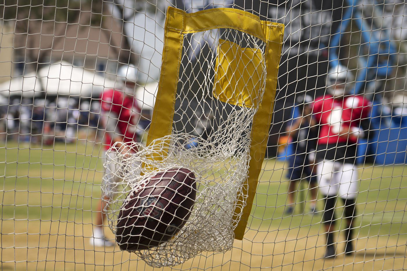 Dallas Cowboys quarterback Dak Prescott hits a target with a pass in a drill during a practice at training camp on Wednesday, Aug. 11, 2021, in Oxnard, Calif.