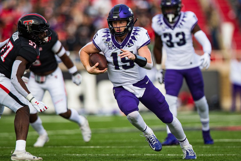 LUBBOCK, TEXAS - NOVEMBER 16: Quarterback Max Duggan #15 of the TCU Horned Frogs runs the ball during the first half of the college football game against the TCU Horned Frogs on November 16, 2019 at Jones AT&T Stadium in Lubbock, Texas. (Photo by John E. Moore III/Getty Images)