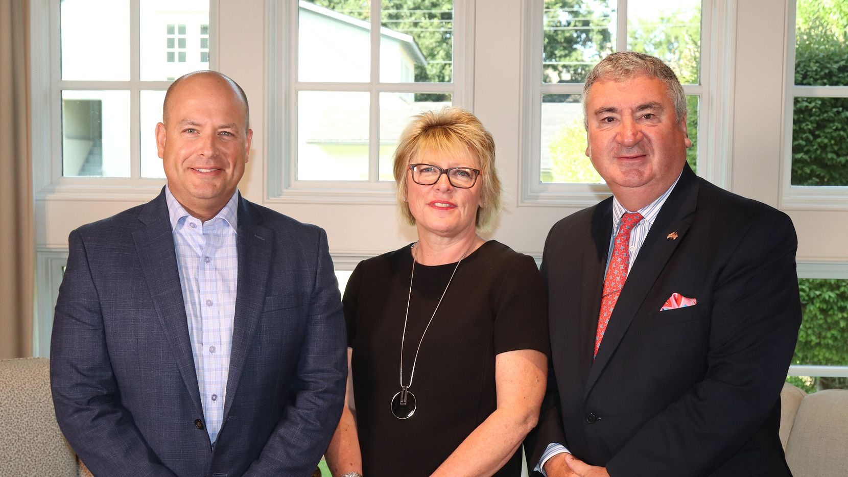 From left, Ebby Halliday Companies president and CEO Chris Kelly and Mayfair International Realty's international director Annette Reeve and managing director Nick Churton.