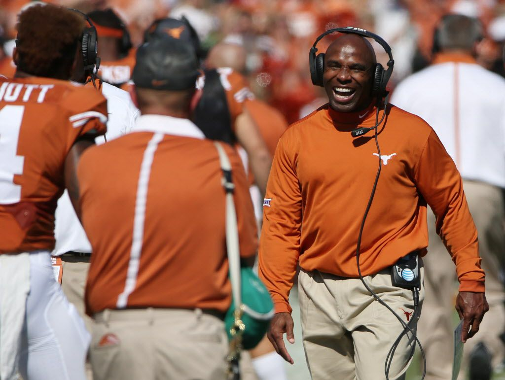 Texas Longhorns head coach Charlie Strong celebrates after a fumble recovery call in favor of Texas was upheld in the first quarter during an NCAA football game between Oklahoma and Texas at the Cotton Bowl in Dallas Saturday October 10, 2015. Texas Longhorns beat Oklahoma Sooners 24-17.