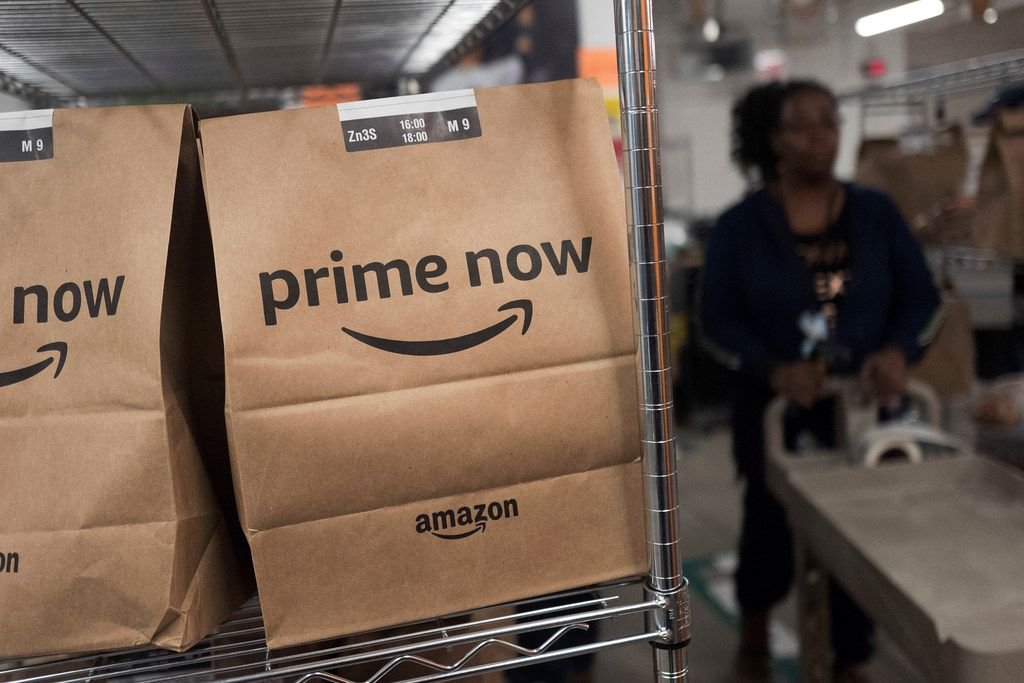 In this Dec. 20, 2017, photo, Prime Now customer orders are ready for delivery at the Amazon warehouse in New York. (AP Photo/Mark Lennihan)