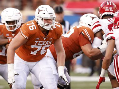 Texas Longhorns tackle Josh Ball (76) looks to block on a running play against the Louisiana-Lafayette Ragin Cajuns at DKR-Texas Memorial Stadium in Austin, Saturday, September 4, 2021.