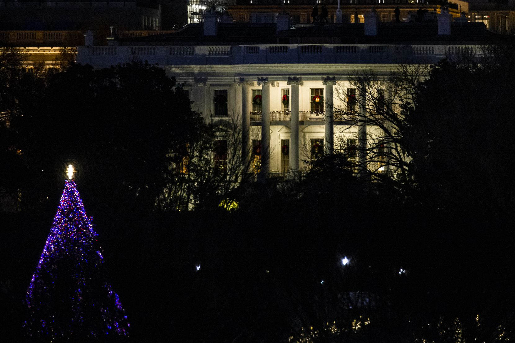 A general view of the White House on Saturday, Dec. 26, 2020, as night falls in Washington, D.C.