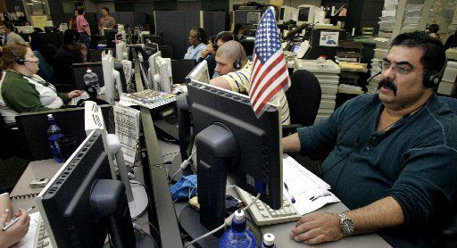 911 call taker Frank Gomez (right) is shown on duty in 2006 in Dallas City Hall. The Dallas Police Department would not allow a tour of the current center.