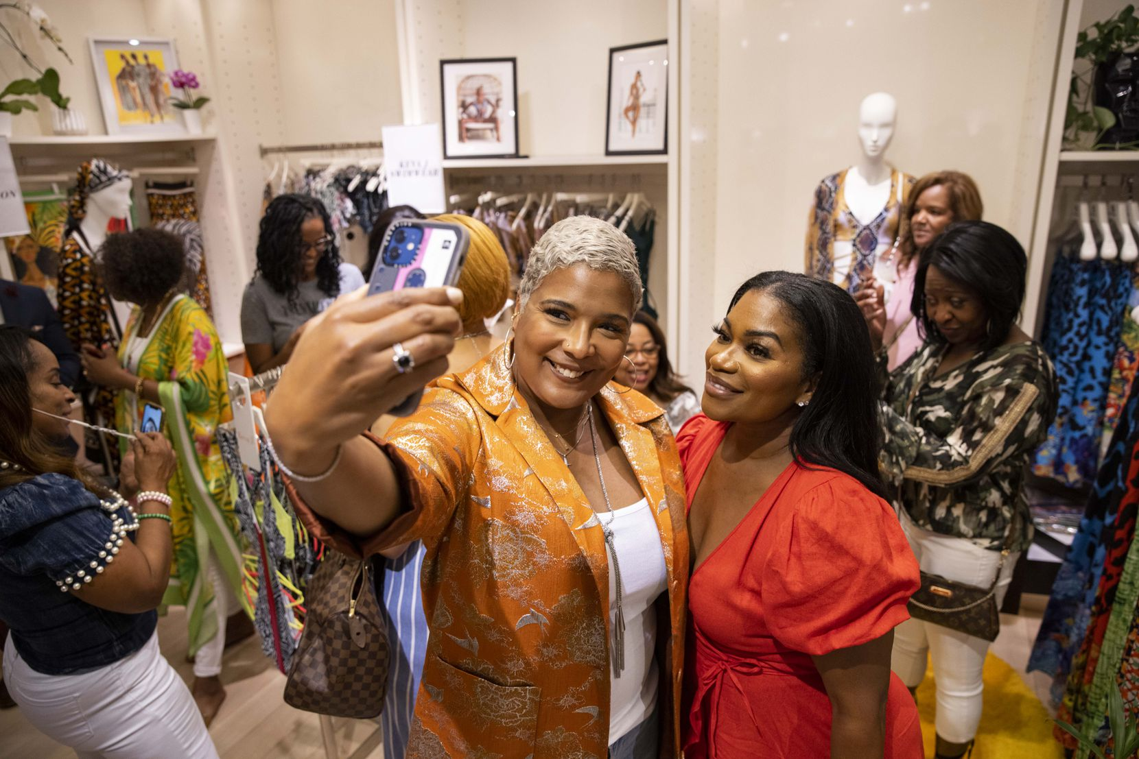 Christine Lynn, left takes a selfie with Tavia Whitlowe at the pop-up.