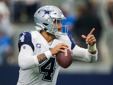 FILE — Dallas Cowboys quarterback Dak Prescott (4) looks for a receiver during the third quarter of an NFL game between the Miami Dolphins and the Dallas Cowboys on Sunday, September 22, 2019 at AT&T Stadium in Arlington, Texas.