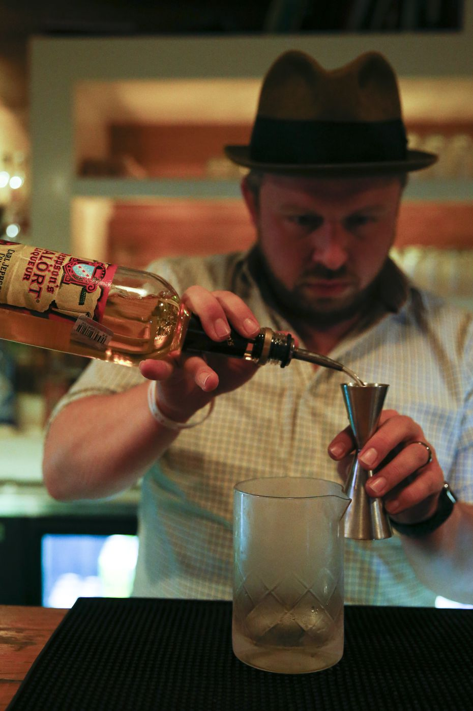 Bartender Jason Pollard mixes the River Runs Backwards cocktail, which utilizes Malort, a Scandinavian-style liqueur known for its off-putting taste, at The Usual bar on Tuesday, Jan. 14, 2020, in Fort Worth.