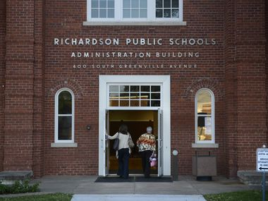 Richardson ISD school board of trustee members Kristin Kuhne (left) and Lanet Greenhaw walk into the RISD Administration Building for a board meeting on Oct. 20, 2014.
