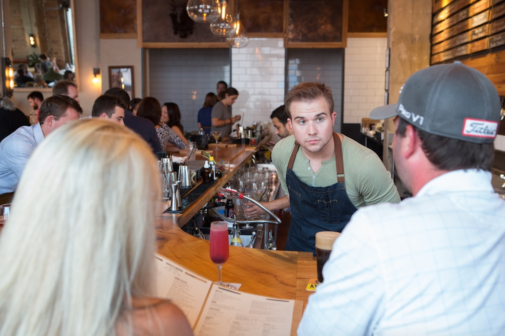 Bartender Adam Salvati takes an order during the soft opening of hotly anticipated restaurant Barley and Board Tuesday, August 11, 2015 in Denton, Texas.