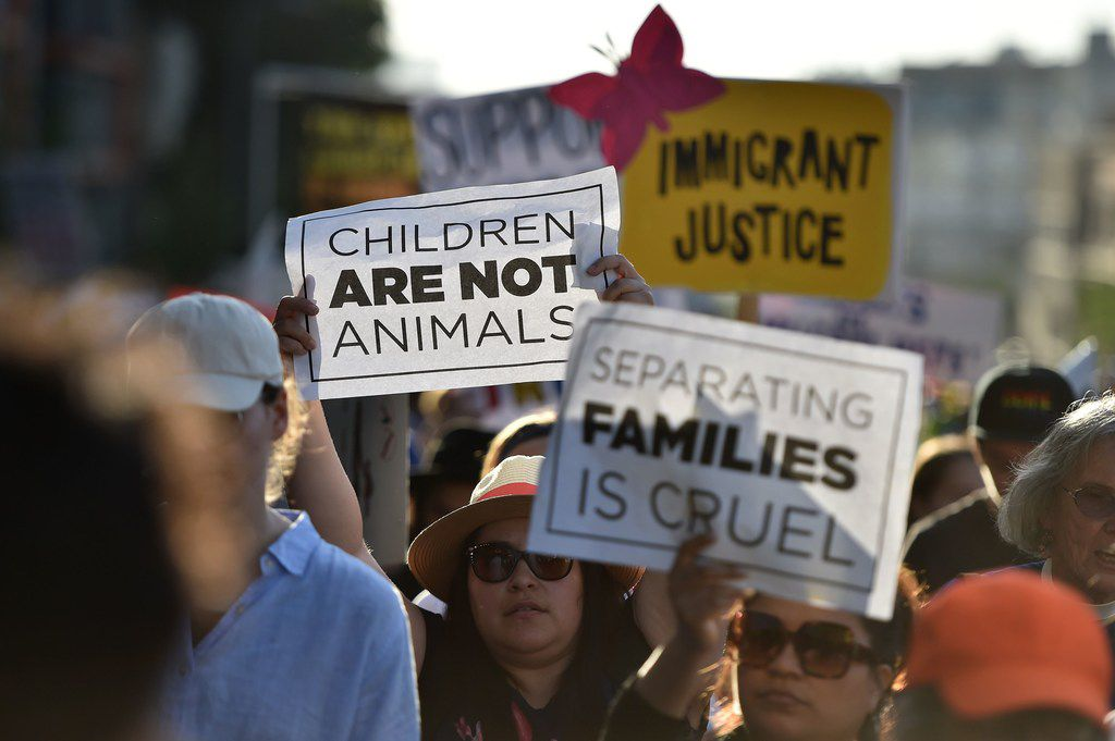 Critics of US government policy which separates children their parents when they cross the border illegally from Mexico protest Thursday during a 'Families Belong Together March' in downtown Los Angeles.