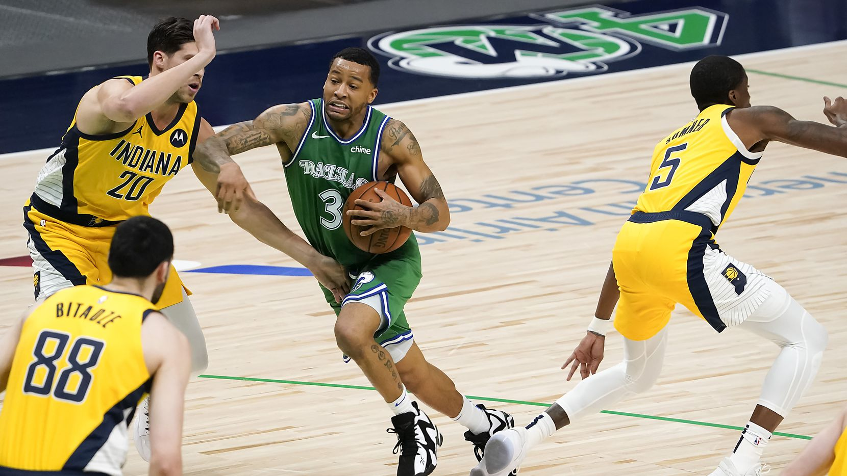 Dallas Mavericks guard Trey Burke (3) drives to the basket against Indiana Pacers forward Doug McDermott (20) during the first half of an NBA basketball game at American Airlines Center on Friday, March 26, 2021, in Dallas.