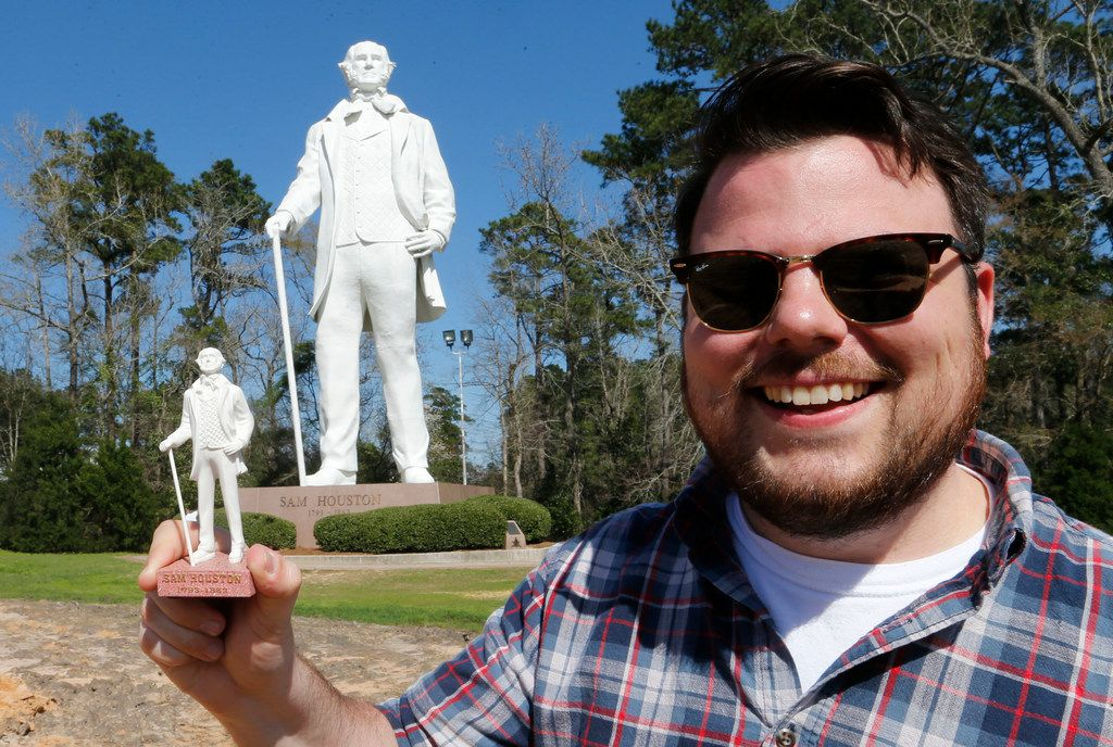 Charles Scudder holds up a miniature version of the Sam Houston statue next to the real Sam Houston statue off Interstate 45 in Huntsville on March 2, 2018. March 2 is Sam Houston's birthday and Texas Independence Day.