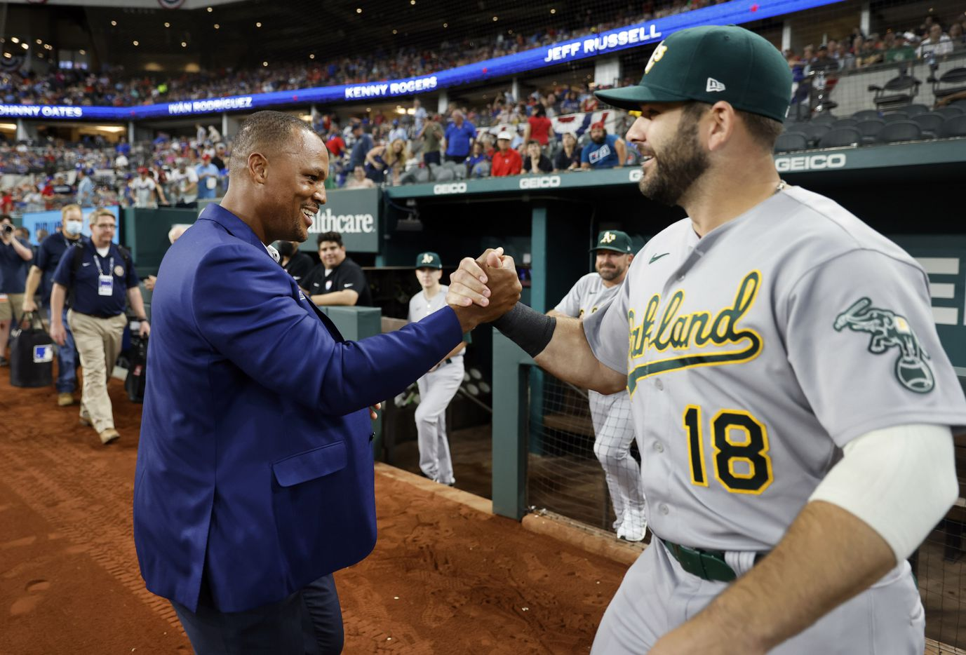 Former Texas Rangers third baseman Adrian Beltre is congratulated on his Texas Rangers Baseball Hall of Fame induction by former teammate and Oakland Athletics designated hitter Mitch Moreland (18) at Globe Life Field in Arlington, Saturday, August 14, 2021.(Tom Fox/The Dallas Morning News)