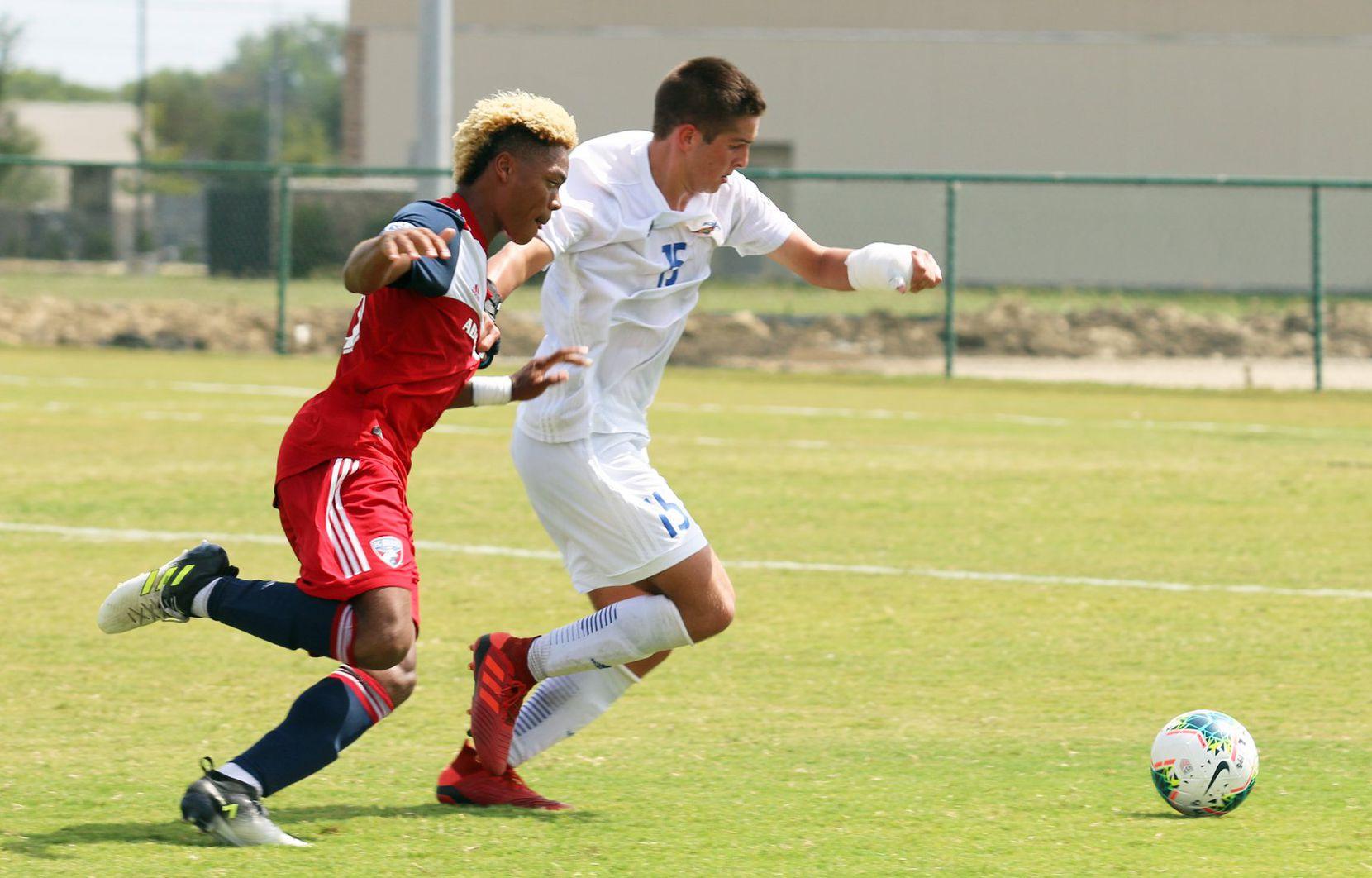 Conner Lewis (#15 white) of Solar SC defends against Malik Henry-Scott of FC Dallas. (9-22-19)