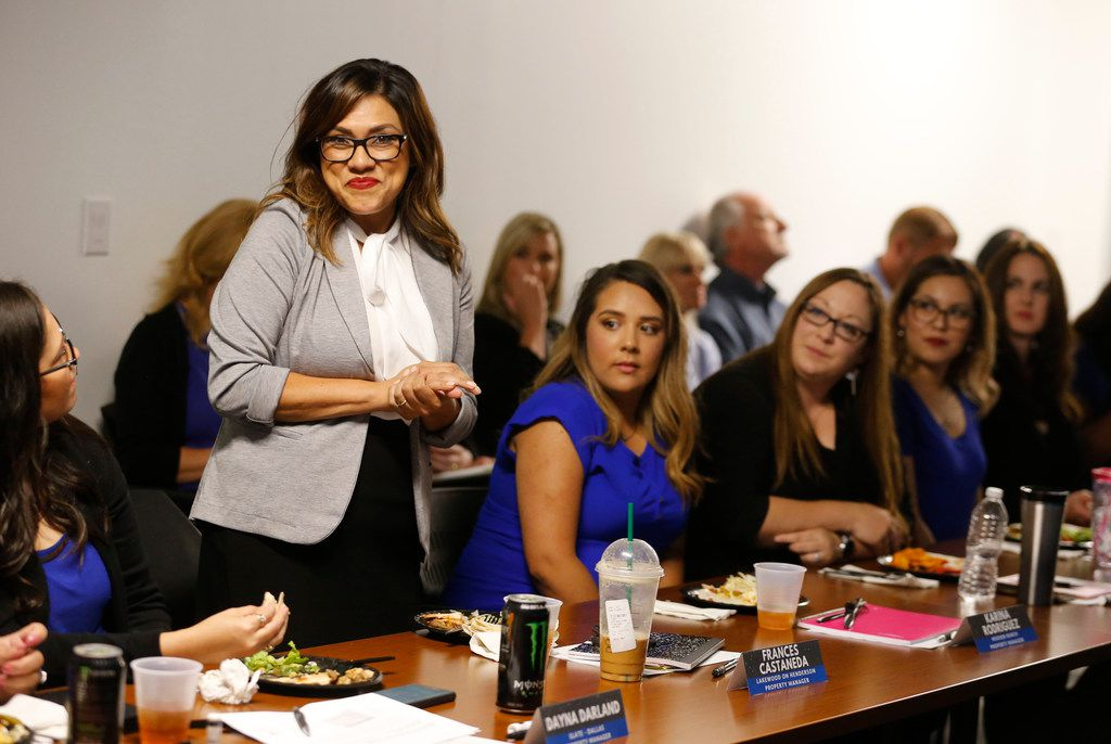 *Frances Castaneda smiles as she introduces herself during a quarterly managers meeting at Valiant Residential in Dallas.