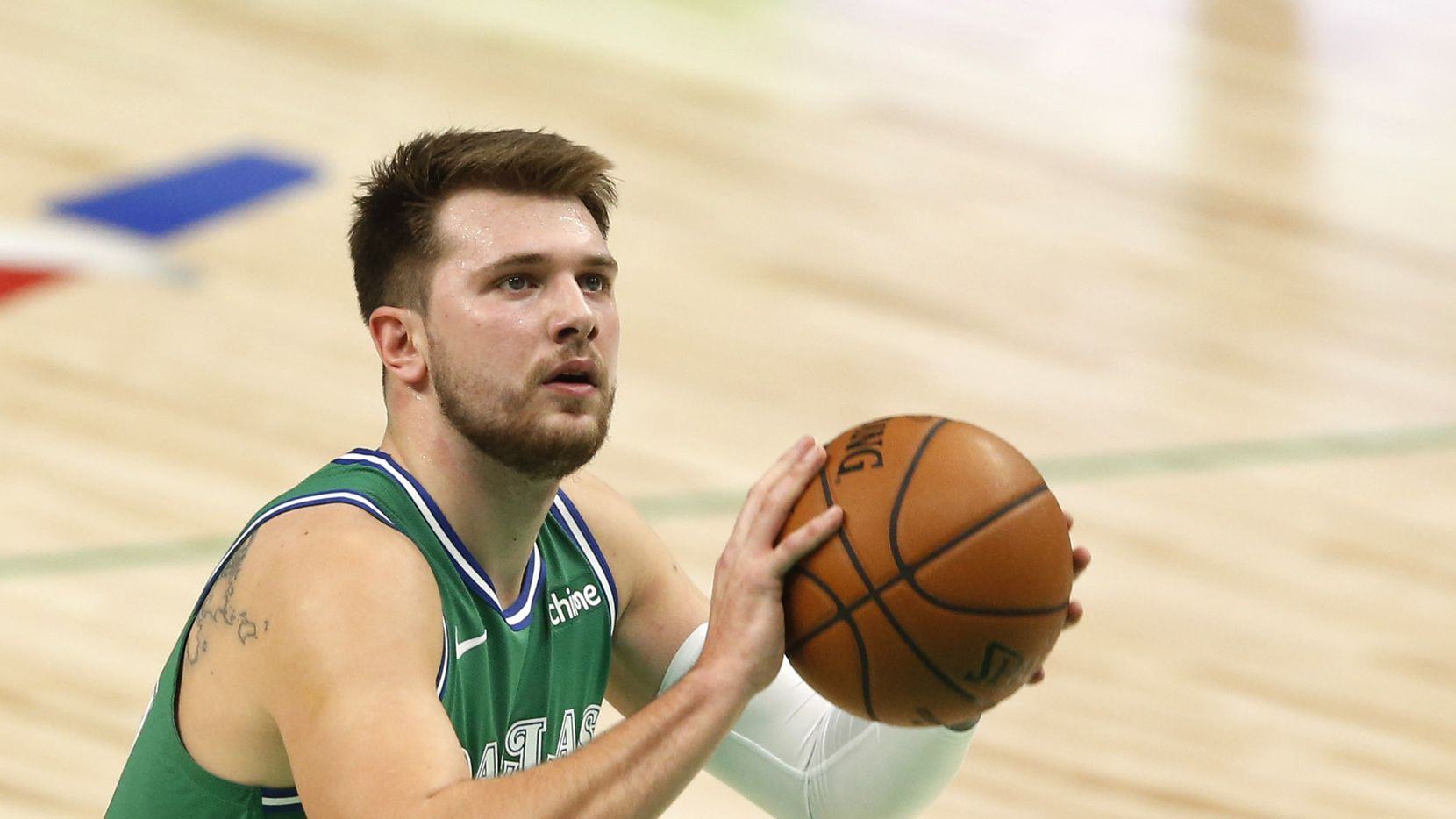 Dallas Mavericks guard Luka Doncic (77) attempts a free throw in a game against the Charlotte Hornets during the first quarter of play in the home opener at American Airlines Center on Wednesday, December 30, 2020 in Dallas.