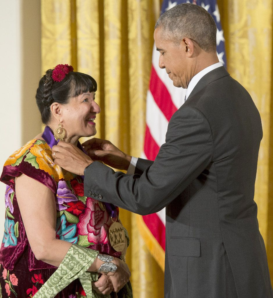 President Barack Obama presents author Sandra Cisneros with the 2015 National Medal of Arts during a ceremony on Sept. 22, 2016.