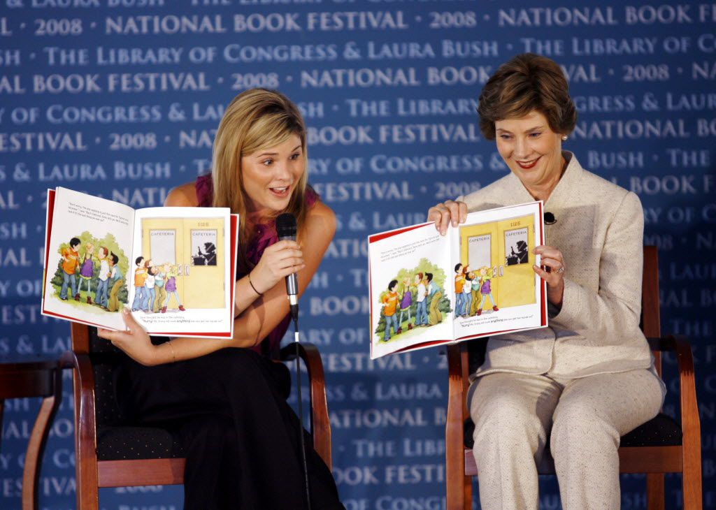 """In this Sept. 27, 2008 file photo, first lady Laura Bush, right, and her daughter Jenna Bush Hager read their book """"Read All About It!"""" during the National Book Festival in Washington. (AP Photo/Jose Luis Magana)"""