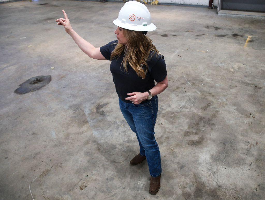 Chris Mullen, vice president of research at Solera, walks around a warehouse that will be transformed into a next-generation auto research and training center. She said the center will help boost the talent pipeline as the auto industry faces a technician shortage.