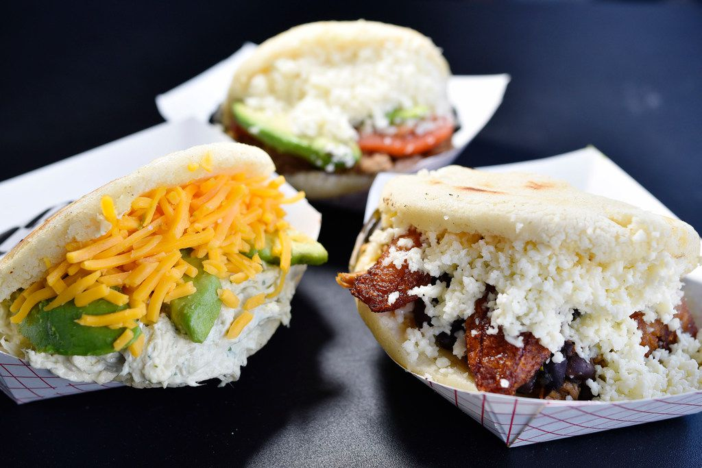 Fancy, left, The Arepa Nation, top, and Pabellon, right, from Arepa Nation at the Dallas Farmers Market.