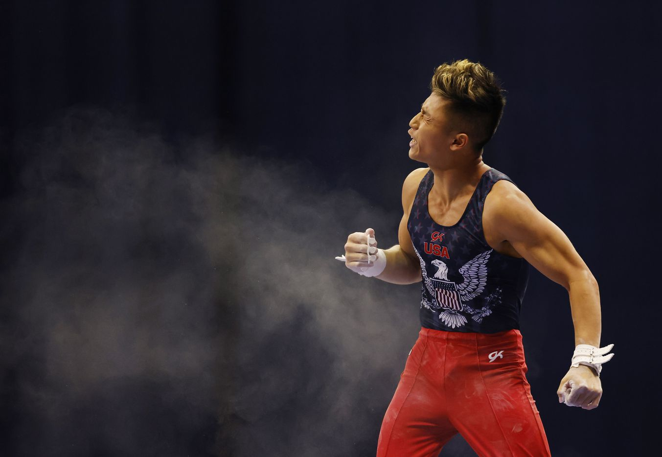 Yul Moldauer celebrates after competing in the high bar during day 2 of the men's 2021 U.S. Olympic Trials at America's Center on Saturday, June 26, 2021 in St Louis, Missouri.(Vernon Bryant/The Dallas Morning News)