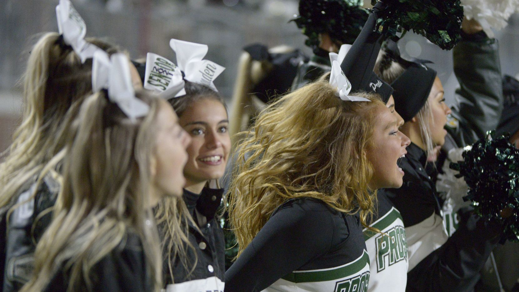 This file photo shows Prosper cheerleaders watching the final minutes of a high school football game between McKinney Boyd and Prosper in 2020.