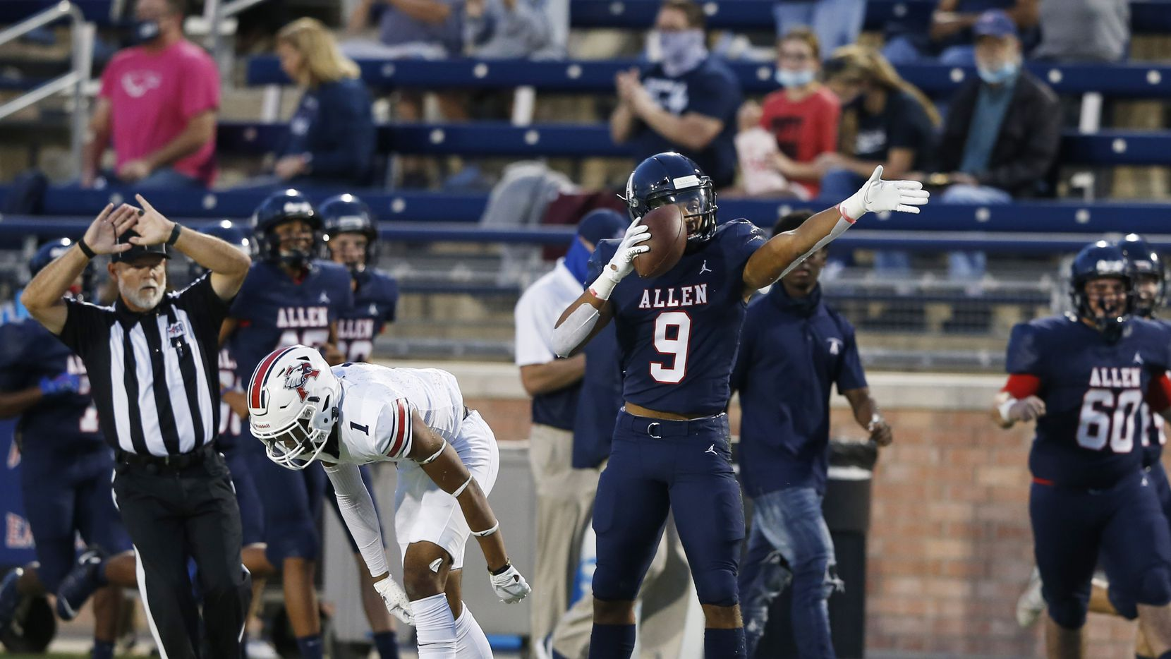 Allen's Bryson Green (9) signals the first down after making a catch in front of Humble Atascocita's Jordan Augustine (1) during the first quarter of play  at Eagle Stadium in Allen, Texas on Friday, October 2, 2020.