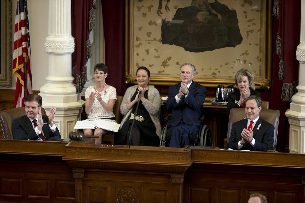 From left, Lt. Gov. Dan Patrick, Tx. Senator Donna Campbell, Texas First Lady Cecilia Abbott, Gov. Greg Abbott, Tx. Rep. Susan L. King and Speaker of the House Joe Straus applaud military members during the Texas Fallen Heroes Memorial Ceremony at the Capitol in Austin, Texas on Saturday, May 23, 2015.  (Deborah Cannon/Austin American-Statesman via AP)