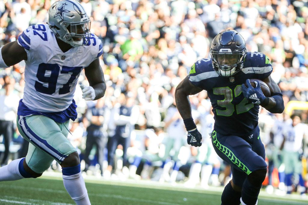 FILE - Dallas Cowboys defensive end Taco Charlton (97) runs after Seattle Seahawks running back Chris Carson (32) during the second half of an NFL game between the Dallas Cowboys and Seattle Seahawks on Sunday, September 23, 2018 at CenturyLink Field in Seattle. (Shaban Athuman/The Dallas Morning News)