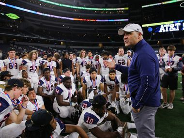 Denton Ryan's head coach Dave Henigan speaks to his team after losing a Class 5A Division I state championship game against Alvin Shadow Creek at the AT&T Stadium in Arlington, on Friday, December 20, 2019. Shadow Creek won 28-22. (Juan Figueroa/The Dallas Morning News)