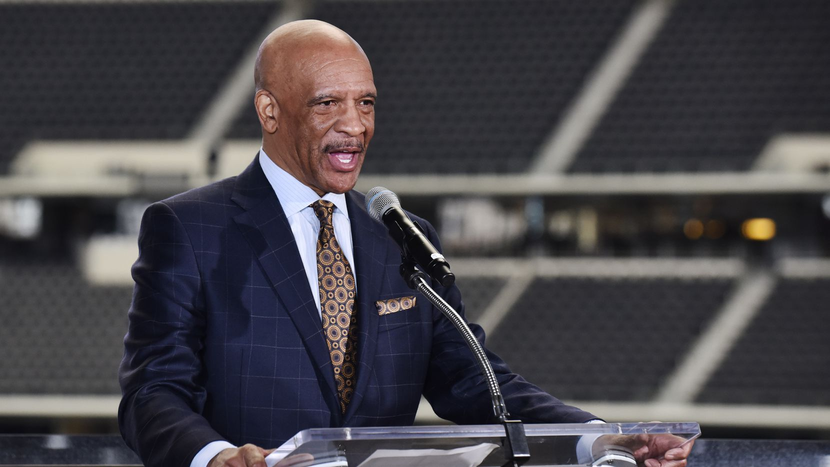 Former Dallas Cowboys player Drew Pearson, left, speaks during a press conference showing the renderings of the NFL Draft Theater and the fan Experience for this year's NFL Draft at AT&T Stadium in Arlington, Wednesday, March 14, 2018.